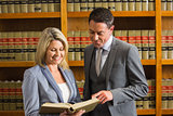 Lawyers reading book in the law library