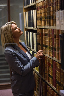 Lawyer picking book in the law library