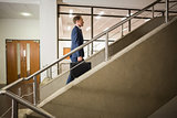 Businessman climbing up the stairs