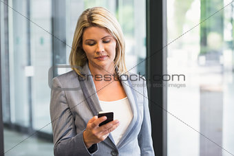 Blonde businesswoman on the phone