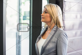 Blonde businesswoman waiting for someone
