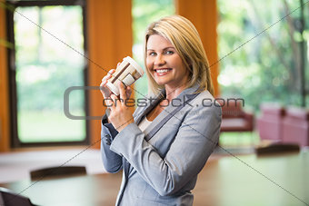 Blonde businesswoman having a coffee