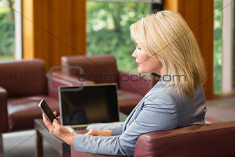 Blonde businesswoman using her phone