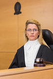 Stern judge looking at camera
