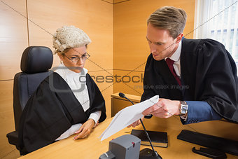 Lawyer speaking with the judge