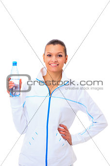Beautiful fit mixed race female model holding a bottle of water