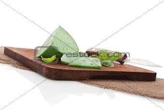 Green cheese on brown cutting board.