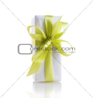Box with yellow-green ribbon