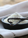 vanilla sugar with natural stick in a wooden bowl