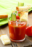 tomato soup gazpacho with crackers and cucumber