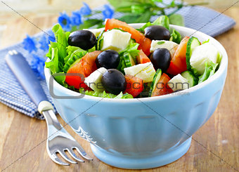 Greek salad with olives cheese and tomatoes
