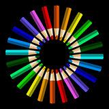 Color pencils in arrange in color wheel colors on black backgrou
