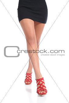 Beauty waxed woman legs walking wearing heels