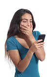 Worried teenager girl looking at smart phone
