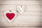 valentine's wooden hearts on a wooden background