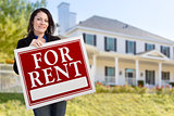 Hispanic Female Holding For Rent Sign In Front of House
