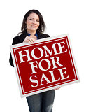 Hispanic Woman Holding Home For Sale Real Estate Sign