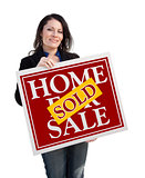 Hispanic Woman Holding Sold Home For Sale Sign on White
