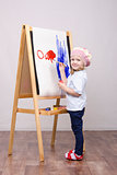 Girl artist paints on canvas