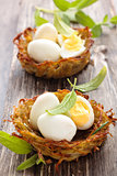 Boiled eggs in nests.