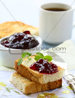 breakfast with fresh toast and cherry jam