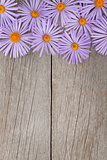 Wooden background with blue flowers