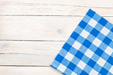 Blue towel over wooden kitchen table