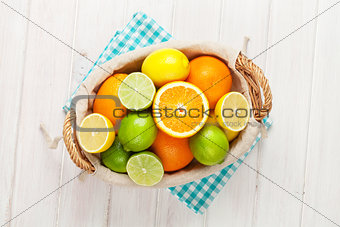 Citrus fruits in basket. Oranges, limes and lemons