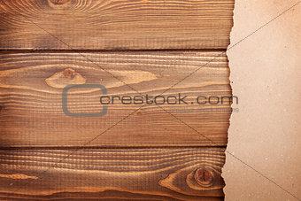 Cardboard paper over wooden background
