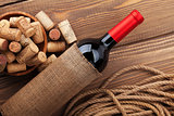 Red wine bottle and bowl with corks