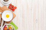 Healthy breakfast with fried egg, tomatoes and salad