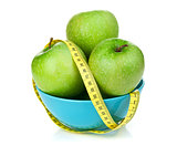 Fresh green apples with yellow measuring tape