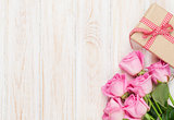 Valentines day background with pink roses and gift box
