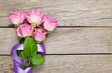 Garden pink roses bouquet over wooden table