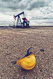 Pumpjack Oil Pump And Protective Helmet