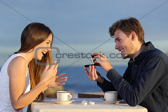 Boyfriend requesting hand of his girlfriend with a engagement ring