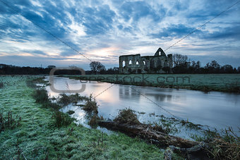 Beautiful sunrise landscape of Priory ruins in countryside