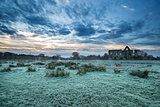 Beautiful sunrise landscape of Priory ruins in countryside locat