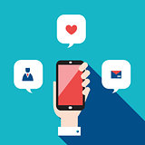 Hand holding mobile phone with icons and speech bubbles Social network concept