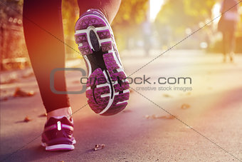 Fitness Girl running at sunset