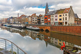 River Leie, colored houses and Belfry tower in Ghent, Belgium