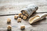 Brown sugar on the wooden background