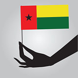 Hand with flag Guinea-Bissau