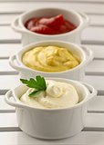 mustard, ketchup and mayonnaise - three kinds of sauces