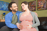 Smiling Mixed Pregnant Couple