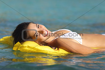 Tourist woman bathing in a tropical sea