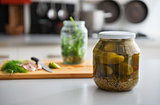 Closeup on jar of pickled cucumbers on table