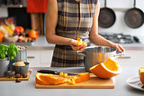 Closeup on young housewife cooking pumpkin