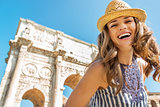 Portrait of happy young woman near arch of constantine in rome,