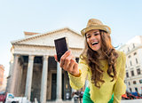 Closeup on happy young woman making selfie in front of pantheon